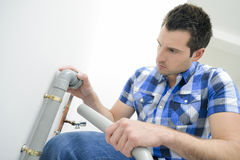 Plumber with plastic pipe Royalty Free Stock Photo