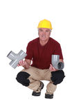 Plumber with plastic pipes Royalty Free Stock Photos