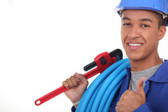 Plumber with plastic piping Stock Images