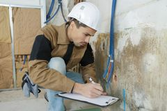 Plumber with plumbing tools. Clipboard royalty free stock images