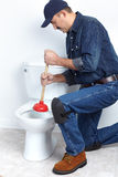 Plumber with a plunger Stock Image