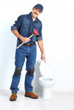Plumber with a plunger Royalty Free Stock Photo
