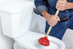 Plumber with a plunger royalty free stock photography