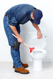 Plumber with a plunger Stock Photos