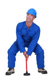 Plumber with plunger Stock Photo
