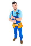 Plumber with plunger and tool belt Royalty Free Stock Photography