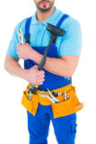 Plumber with plunger and tool belt Royalty Free Stock Images