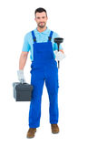Plumber with plunger and toolbox Stock Photo