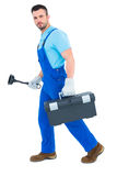 Plumber with plunger and toolbox Royalty Free Stock Photo