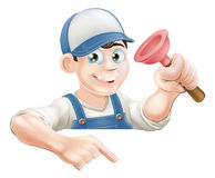 Plumber pointing at sign Stock Images