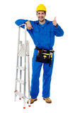 Plumber posing confidently with thumbs up Stock Photography