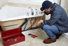 Plumber. Professional plumber doing plumbing renovation in bathroom Stock Photo