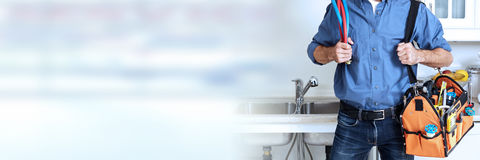 Plumber. Professional plumber working renovation in kitchen home Stock Photography