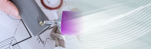 Plumber putting glue on a pvc pipe. panoramic banner royalty free stock photography