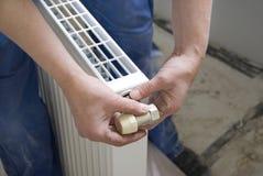 Plumber radiator royalty free stock image
