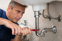 Plumber Repair Water Pipe Royalty Free Stock Photography