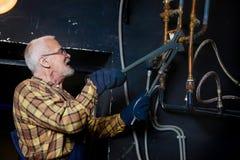 Plumber repairing pipes Stock Photos