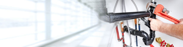 Plumber. Plumber repairing a sink. Construction and renovation background stock photo