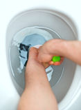 Plumber. Plumber repairing toilet with hand plunger stock photos