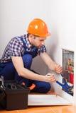 Plumber repairing tubes Royalty Free Stock Photo
