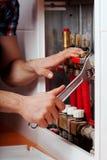 Plumber repairing volves Stock Image