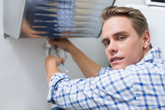 Plumber repairing washbasin drain in bathroom Royalty Free Stock Photo