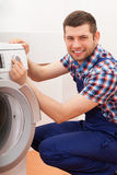 Plumber repairing washing machine Stock Image