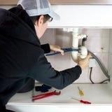 Plumber repairman Stock Images