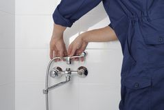 Repair of a water tap royalty free stock images