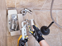 Plumber Repairs Sink Trap In Bathroom Stock Photography