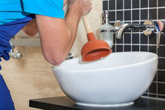 Plumber with rubber plunger Royalty Free Stock Photos