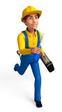 Plumber running with screw driver Royalty Free Stock Image