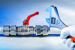 Free Plumber`s Hands Using Wrench At Work Stock Image - 146070081