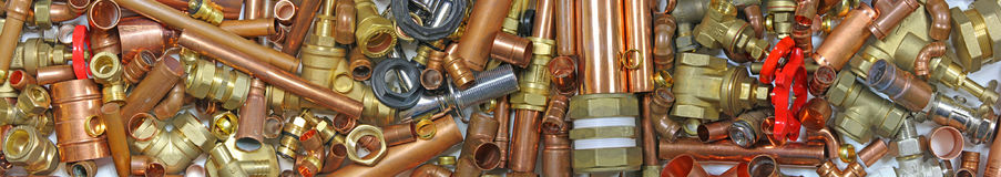 Plumber`s pipes and fitting Stock Images