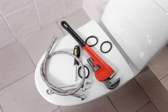 Plumber`s tools on toilet Stock Photos