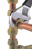 Plumber`s wrench tightening up copper 15mm pipework Stock Image