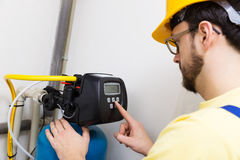 Plumber set up water filtration system Stock Photos
