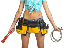Plumber in shorts, shirt, tool belt with tools Royalty Free Stock Photography