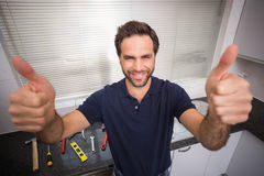 Plumber smiling at the camera Stock Images