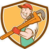 Plumber Smiling Holding Monkey Wrench Crest Stock Photos