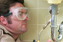 Plumber Soldering Stock Photos