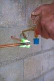 Plumber soldering copper pipe Stock Photos