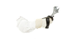 Plumber spanner with protective hand gloves, hand. Royalty Free Stock Image