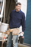 Plumber standing with van Stock Photography