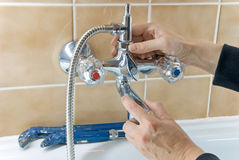 Plumber and tap stock photo