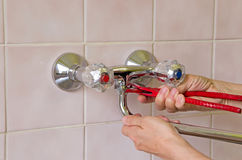 Plumber and tap Stock Image