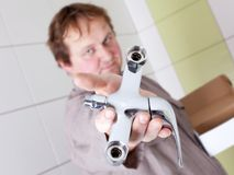 Plumber with a tap Royalty Free Stock Photography