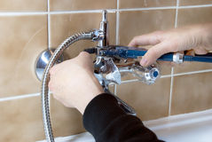 Plumber and tap Royalty Free Stock Image
