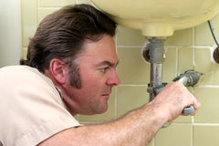 Plumber Tightening Pipe Stock Image