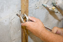 Plumber Tightens Nut Stock Photography